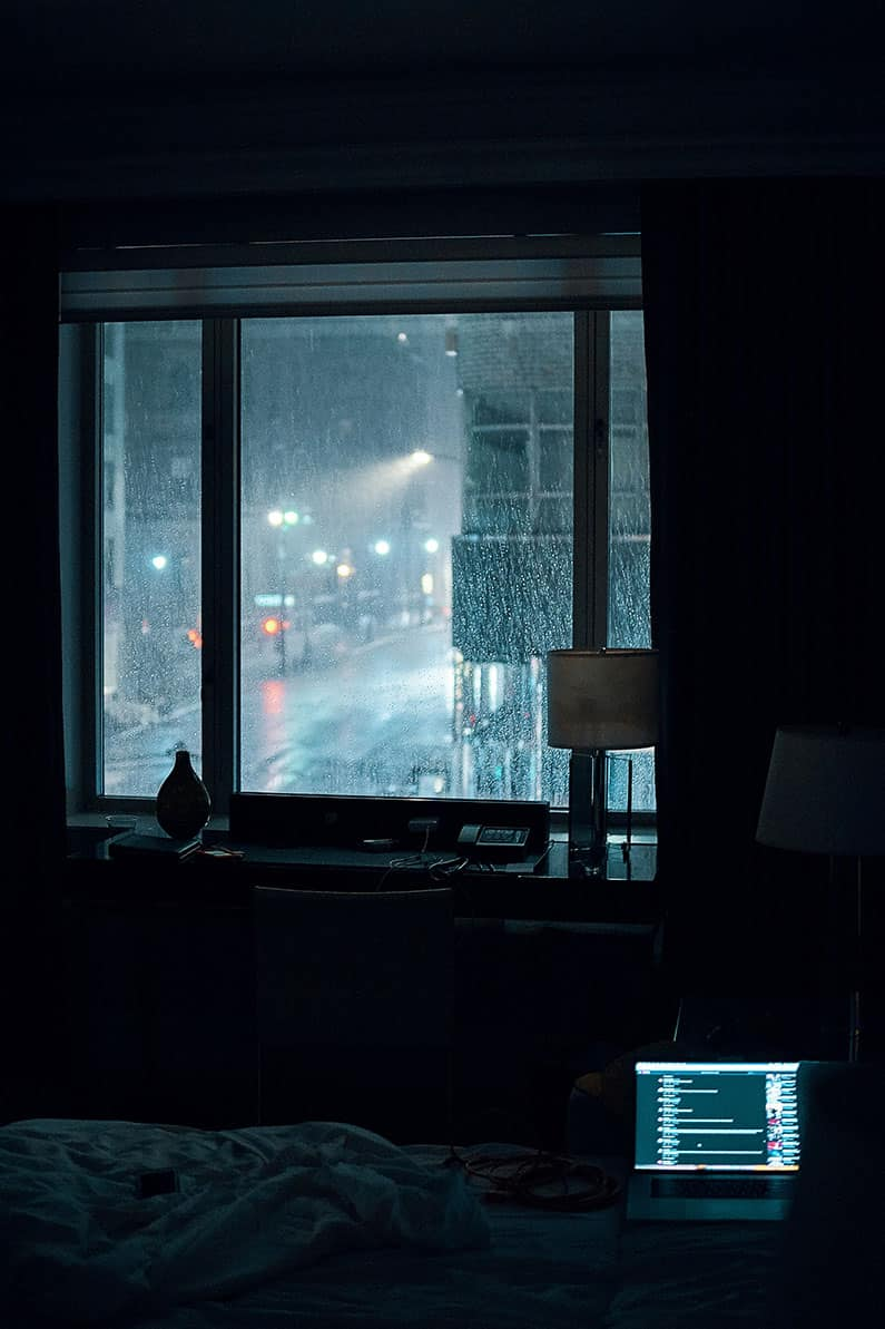 Rainy night with lighted Macbook Pro